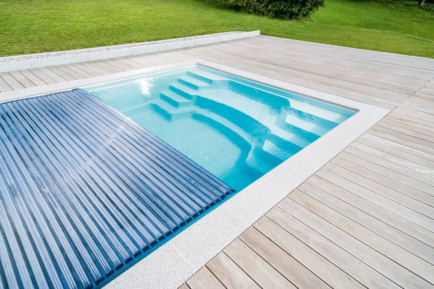 novermber R Model 10M ceramic-fibreglass swimming pool with Roll-away safety cover