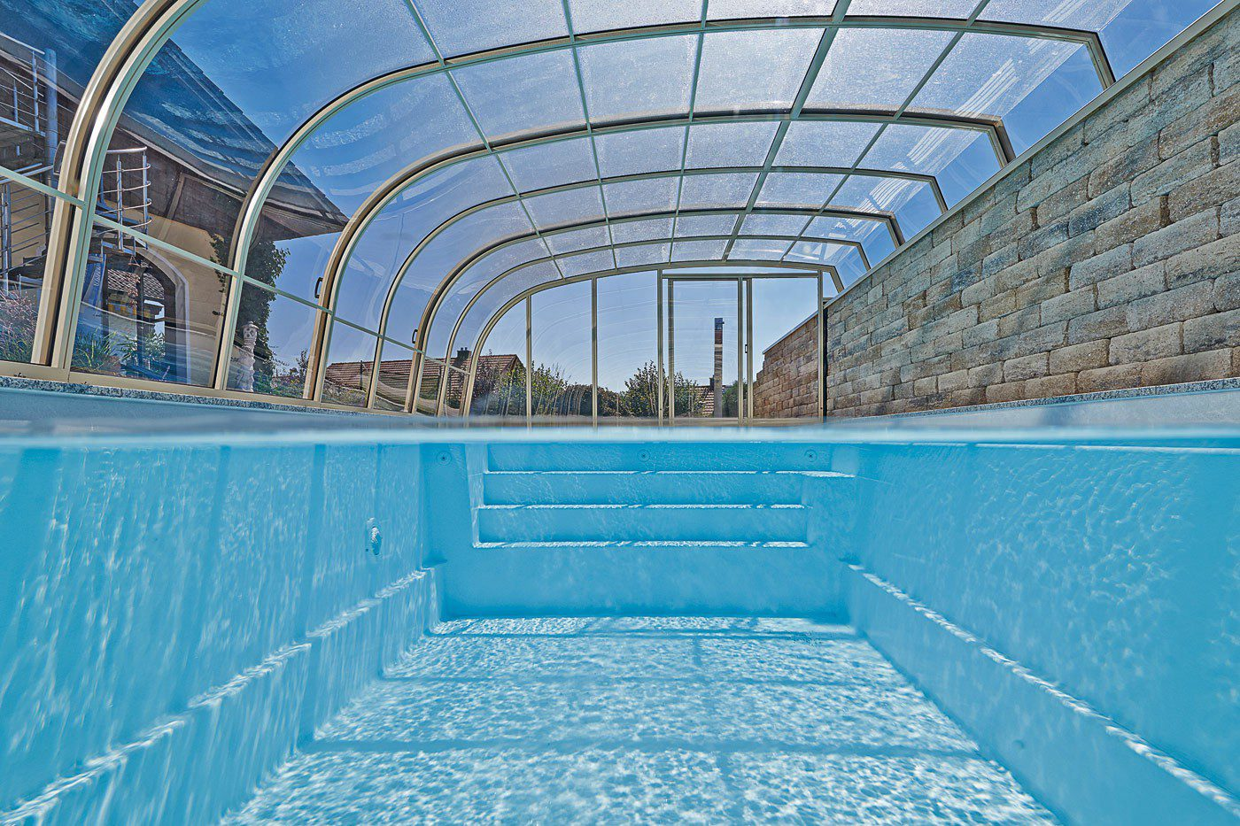 Oscar 9M ceramic-fibreglass core swimming pool with steps and safety cove